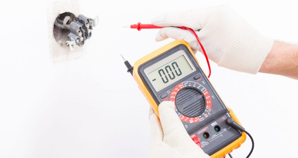 38335680 - electrician checking socket voltage with digital multimeter